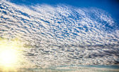 Beautiful striped clouds. HDR image — Stock Photo