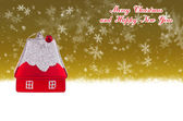 Merry Christmas and Happy New Year gold background with Christmas toy in the form of a small house — Stock Photo