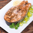 Salmon steak with vegetables cooked on the grill — Stock Photo
