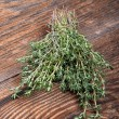 Bunch of fresh thyme on a wooden board — Stock Photo