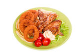Grilled chicken wings with French fries and onions rings — Photo