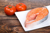 Fresh raw salmon red fish steak with herbs, spices and vegetables — ストック写真