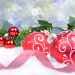 Christmas background with red balls and holly leaves and berries — Stock Photo #36712285