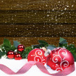 Christmas background with red balls and holly leaves and berries — Stock Photo