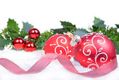 Christmas background with balls and holly leaves and berries isolated on the white background — Stock Photo