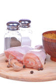 Fresh chicken legs on cutting board. Isolated on a white — Stock Photo