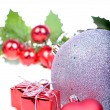 Christmas background with balls, holly leaves and berries — Stock Photo