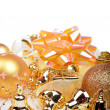 Christmas background with golden balls and bells — Stock Photo