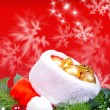 Christmas background with red Santa Claus hat and holly leaves — Stock Photo #36972791