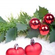 Christmas background with red balls, hearts, holly leaves and berries — Stock Photo