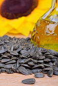 Fresh sunflower seeds oil in a bottle — 图库照片