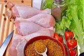 Fresh chicken legs on cutting board — Stock Photo