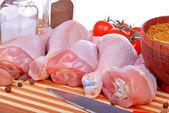 Fresh raw chicken legs on cutting board — Stock Photo