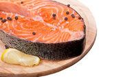 Fresh raw salmon red fish steak with herbs and spices — Stock Photo