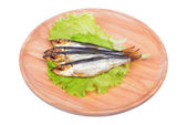 Smoked fish and salad on a wooden board isolated on white background — Stok fotoğraf