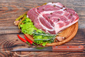 Raw meat selection with herbs and pepper — Stock Photo