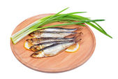Smoked fish and onion isolated on white background — Foto Stock