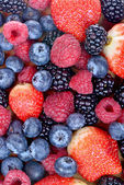 Different fresh berries as background. Top view — Zdjęcie stockowe