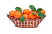 Tangerine or mandarin fruit in the basket isolated on white background — Stock fotografie