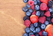 Different fresh berries as background. Top view — Stock Photo