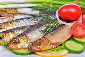 Smoked fish, salad and onion — Stock Photo