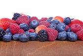 Different fresh berries as background — Stock fotografie
