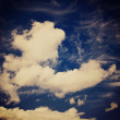 Stock Photo: Blue sky and puffy clouds with retro effect