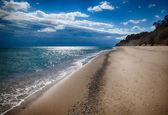 Empty sandy beach near the sea. HDR image — Stock Photo
