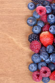 Different fresh berries as background. Top view — Stok fotoğraf