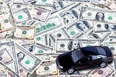 Car on money background - business concept — Stock Photo