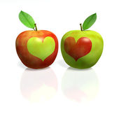 Red apple with green heart and green Apple with red heart — Stock Photo