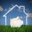Royalty-Free Stock Photo: Piggy bank - drawn house in the sky (profil)