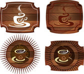 Coffee Emblems on wood texture — Stock Vector