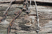 Rundown wood and barbed wire — Stock Photo