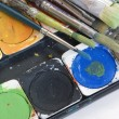 Watercolor box and brushes — Stock Photo