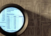 Stock index and magnifier — Stock Photo