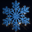 Twinkling blue snowflake — Photo