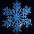 Twinkling blue snowflake — Stock Photo