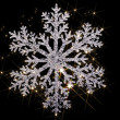 Twinkling snowflake — Stock Photo