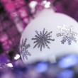 White Christmas bauble with metallic ornaments — Stock Photo