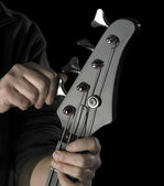 Bass guitar tuning — Stock Photo