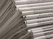 Lots of newspapers — Stockfoto