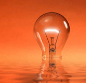 Sinking light bulb — Stock Photo