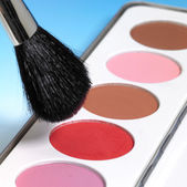 Make-up colors and brush — Stock Photo