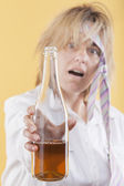 Drunk woman holding bottle. — Stock Photo
