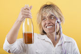 Drunk woman with bottle — Stock Photo