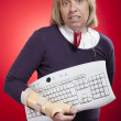 Woman holding a keyboard with carpal tunnel injury — ストック写真