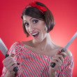 Royalty-Free Stock Photo: Pin up girl holding a kitchen knife.