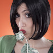 Kissing a dollar — Stock Photo