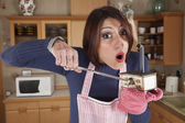 Woman caught in a mini kitchen — Stock Photo